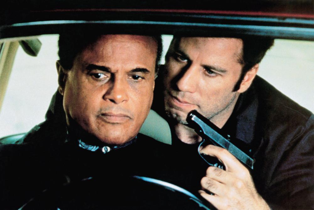 John Travolta (r) takes his boss Harry Belafonte (l) hostage at gunpoint in White Man's Burden (1995)