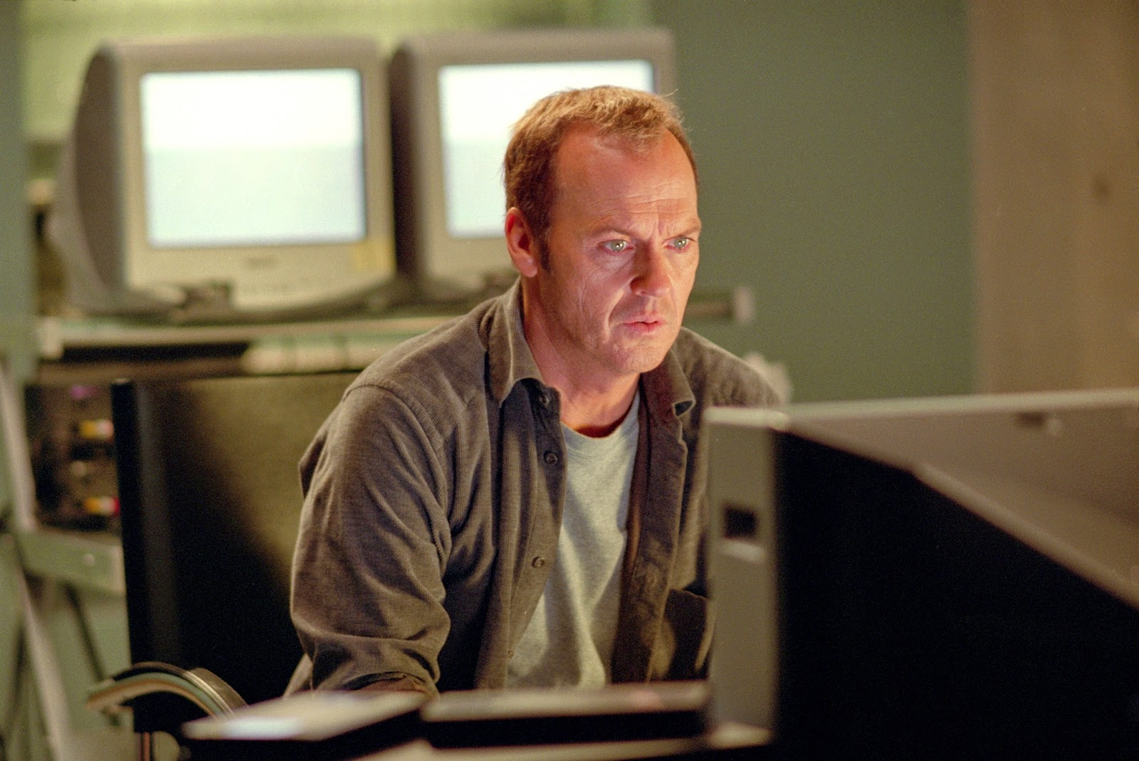 Widower Michael Keaton becomes obsessed with contacting his late wife via Electronic Voice Phenomenon in White Noise (2005)