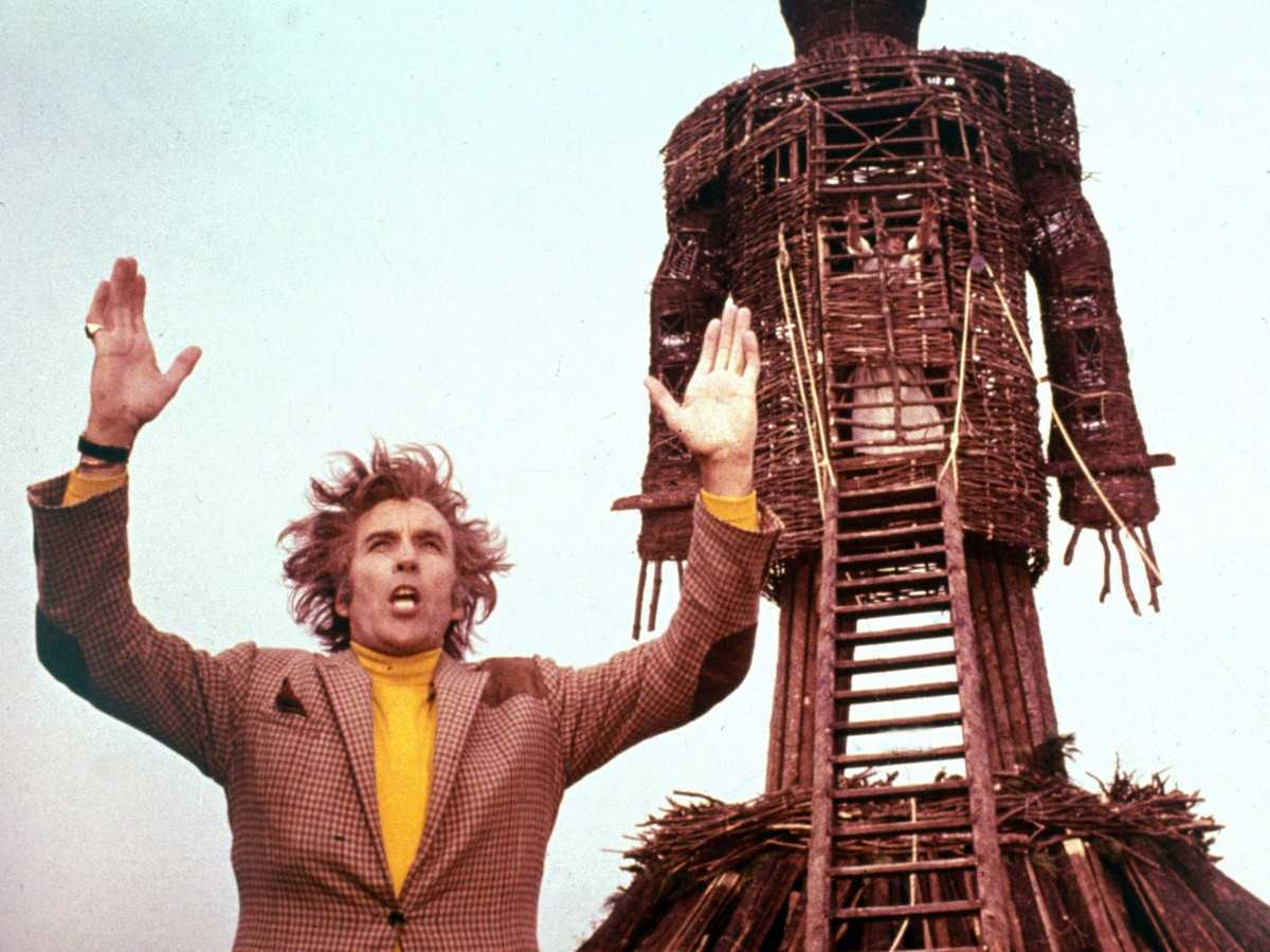 Lord Summerisle (Christopher Lee) stands before The Wicker Man (1973)