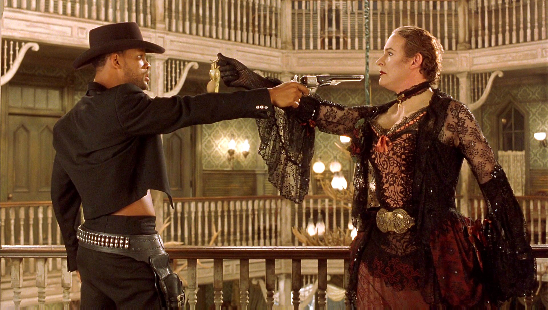 Will Smith and a drag-outfitted Kevin Kline in a Mexican standoff in Wild Wild West (1999)