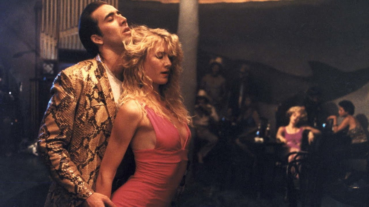 Sailor Ripley (Nicolas Cage) and Lula Fortune (Laura Dern) dance in Wild at Heart (1990)