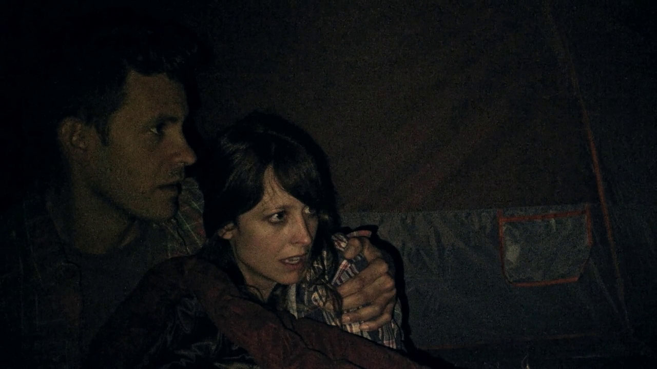Bryce Johnson and Alexie Gilmore huddle frightened in their tent in Willow Creek (2013)