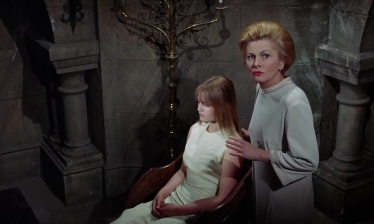 Schoolteacher Joan Fontaine (r) tries to save pupil Ingrid Brett (l) from The Witches (1966)