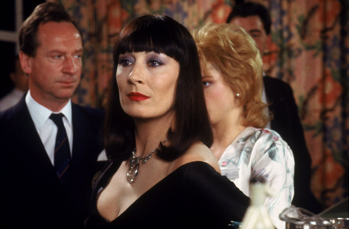 Anjelica Huston as Miss Ernst (c) with (behind l to r) Bill Paterson and Jane Horrocks in The Witches (1990)