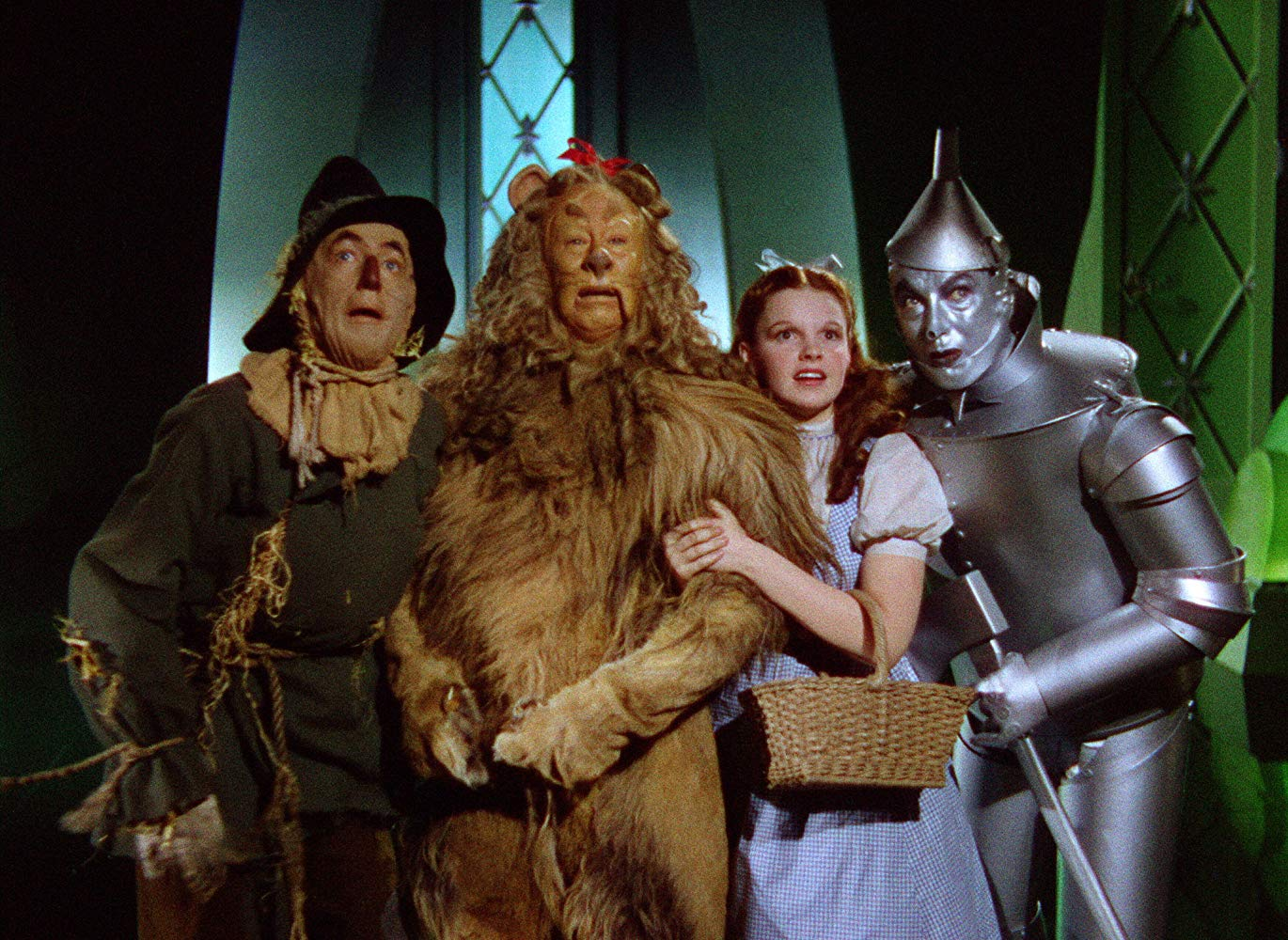 The Scarecrow (Ray Bolger), The Cowardly Lion (Bert Lahr), Dorothy (Judy Garland) and The Tin Woodsman (Jack Haley Sr) in The Wizard of Oz (1939)