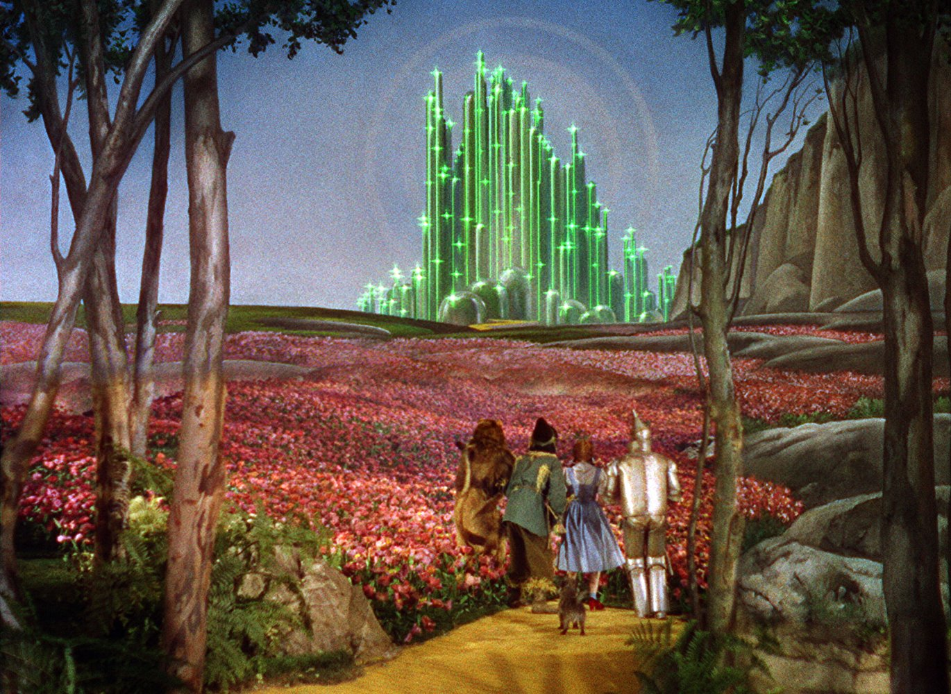 Dorothy and companions off down the Yellow Brick Road to the Emerald City of Oz in The Wizard of Oz (1939)