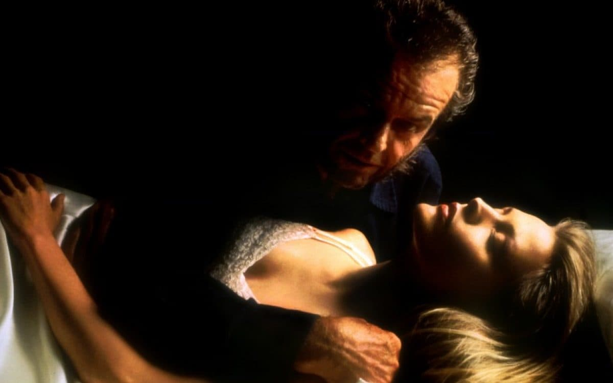 Jack Nicholson hovering over a sleeping Michelle Pfeiffer in Wolf (1994)