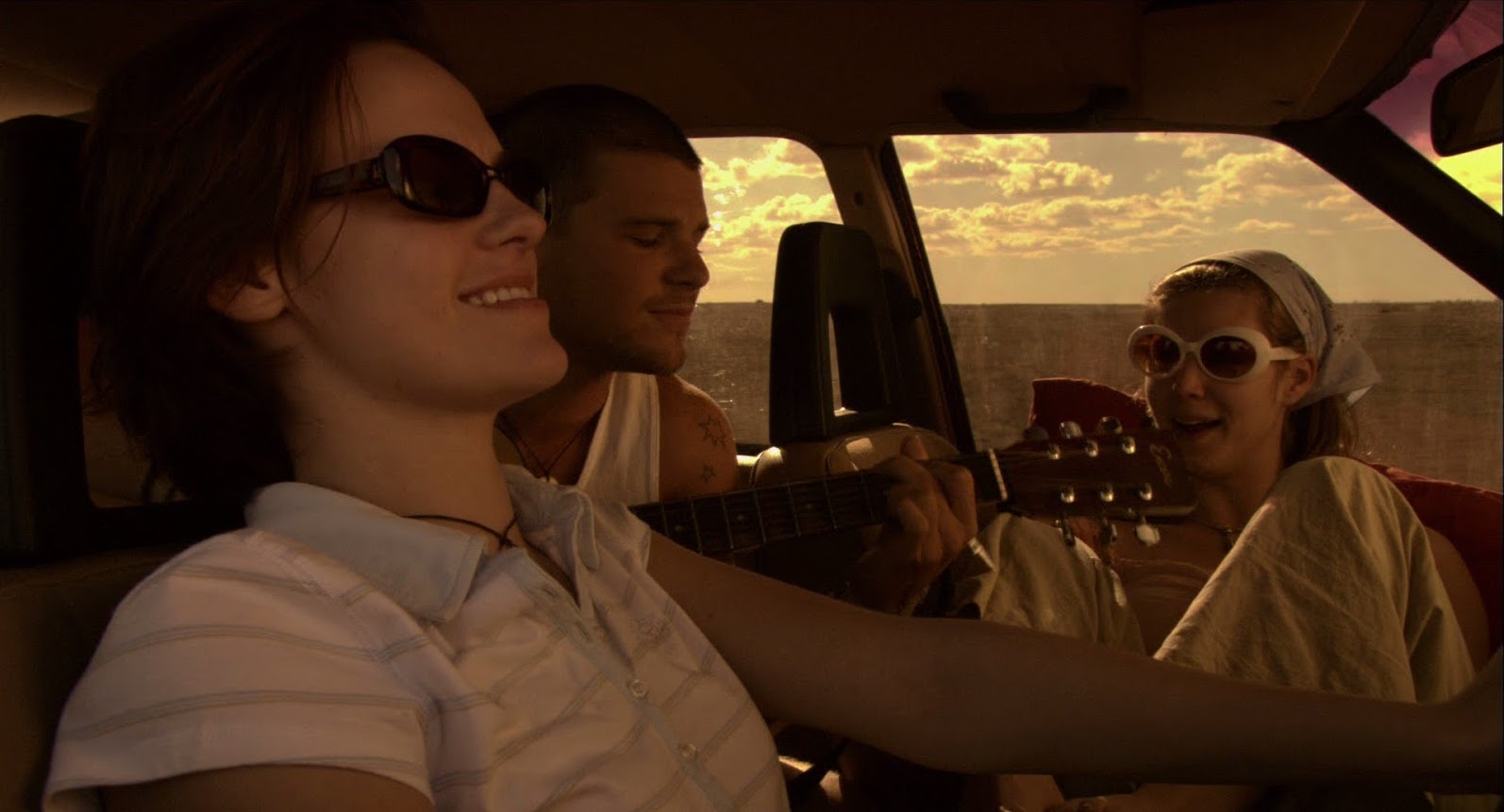 Backpackers on a trip through the Outback - Cassandra Magrath, Nathan Phillips, Kestie Morassi in Wolf Creek (2005)