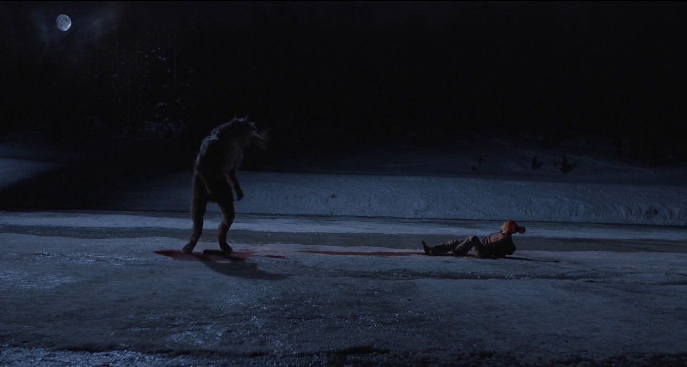 The wolf attacks Hannah Elder in The Wolf of Snow Hollow (2020) 1