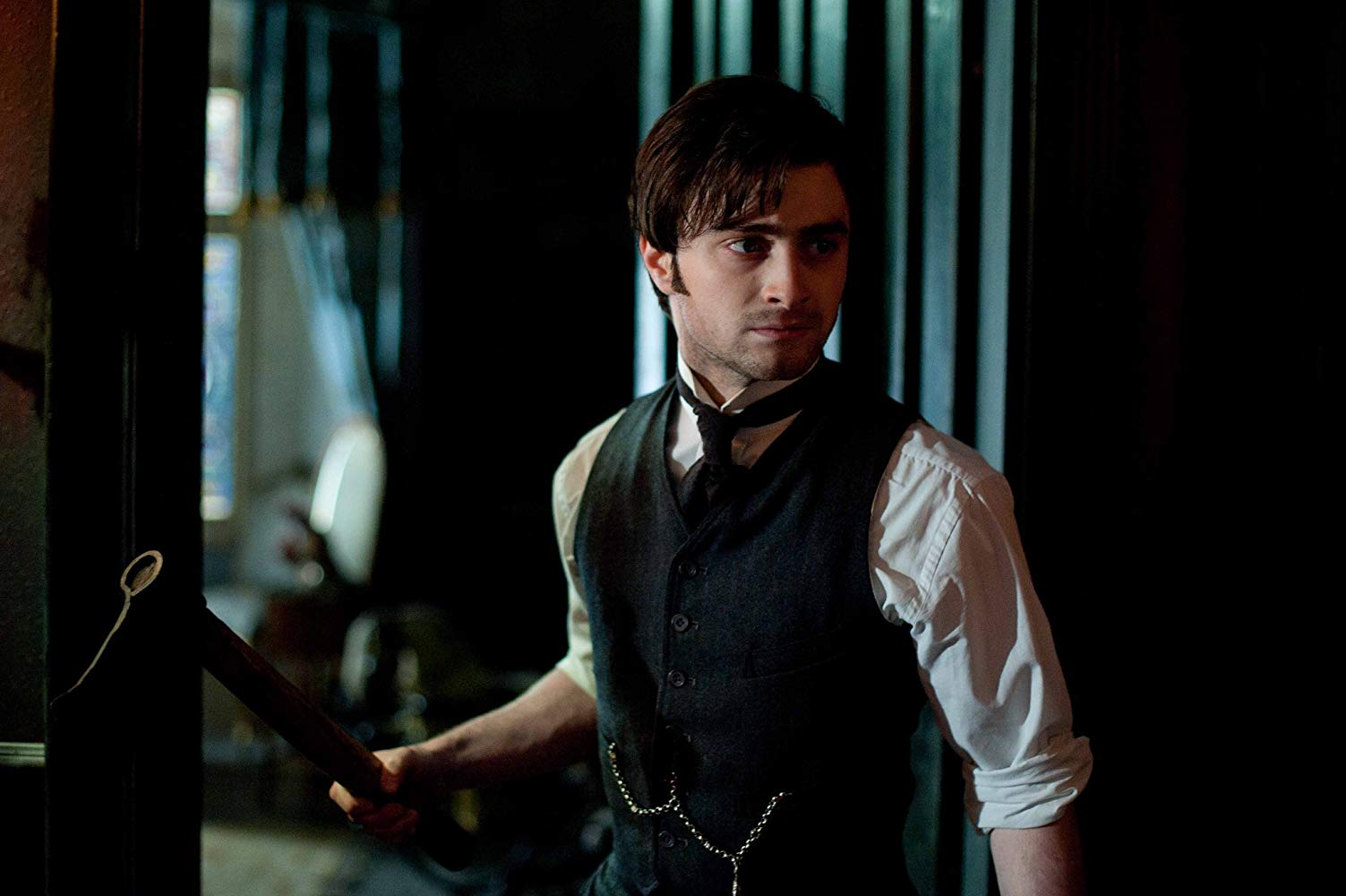 Arthur Kipps (Daniel Radcliffe) searches the house in The Woman in Black (2012)
