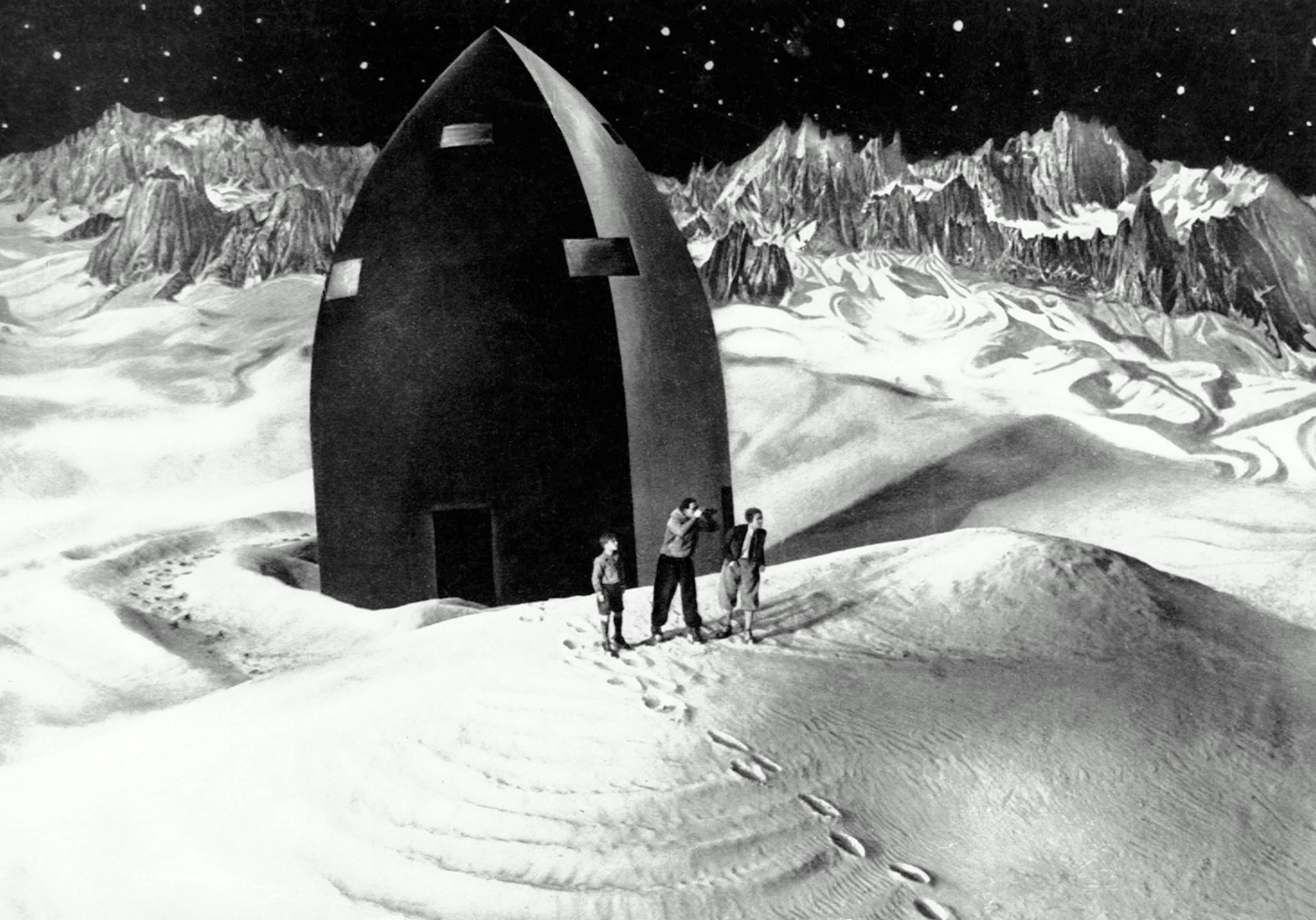 The rocket landed on The Moon as the explorers - (l to r) Gustl Gstettenbaur, Willy Fritsch and Gerda Marcus - set out in Woman in the Moon (1929)