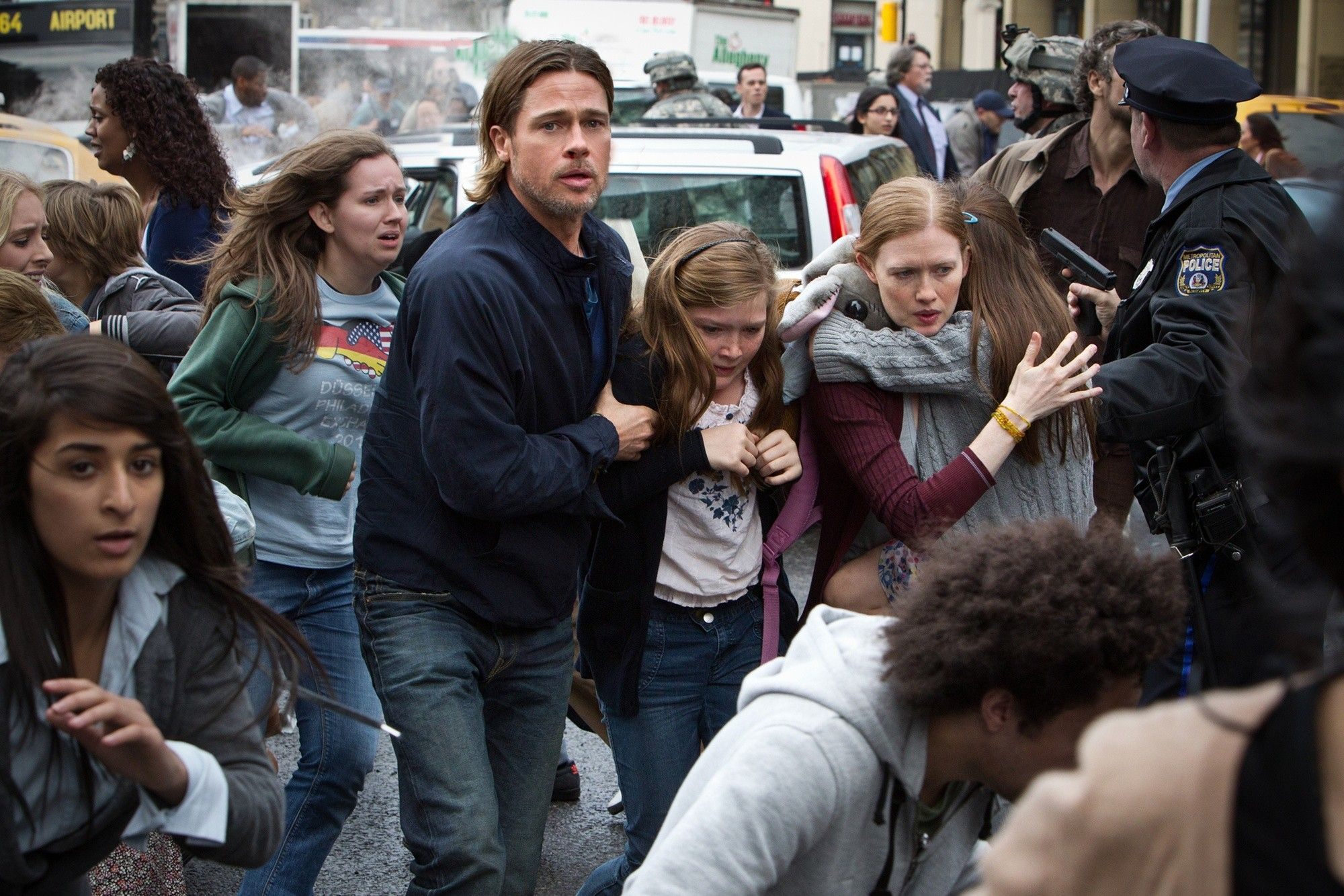 Brad Pitt and family attempt to escape the zombie onslaught in the streets of Philadelphia in World War Z (2013