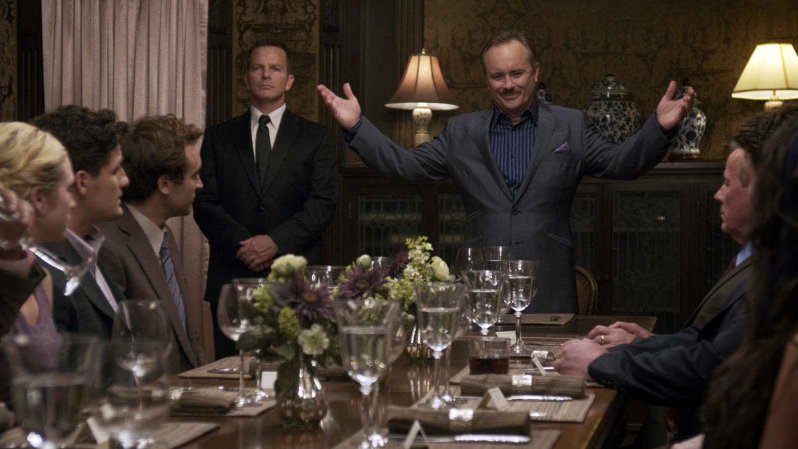 Millionaire Shepard Lambrick (Jeffrey Combs) introduces the contestants to his game over dinner in Would You Rather (2012)