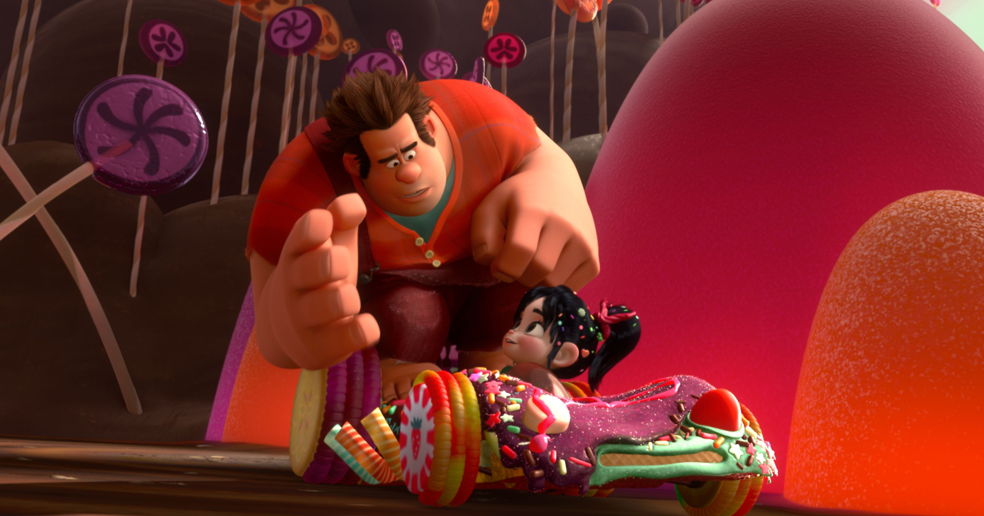 Wreck-It Ralph (voiced by John C. Reilly) and Vanellope von Schweetz (voiced by Sarah Silverman) in her candy racing car in Wreck-It Ralph (2012)