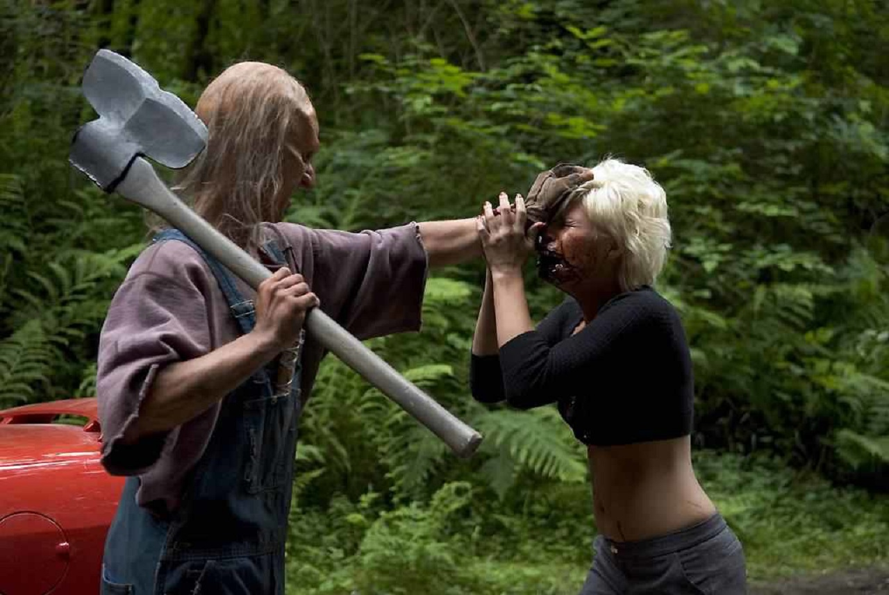 Three Finger (Jeff Scrutton) attacks Kimberly Caldwell in Wrong Turn 2: Dead End (2007)