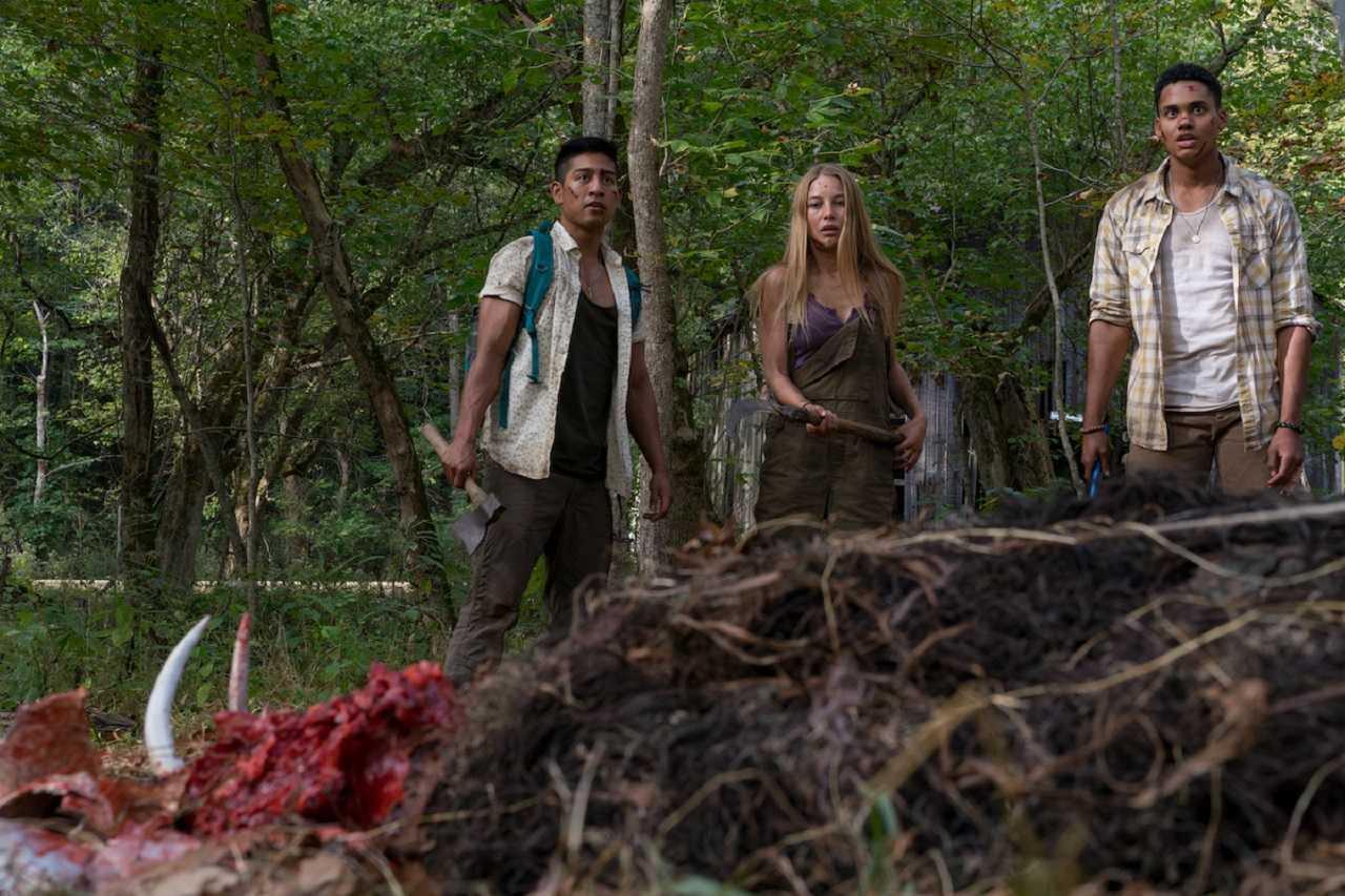 (l to r) Adrian Favela, Charlotte Vega and Adain Bradley in Wrong Turn (2021)