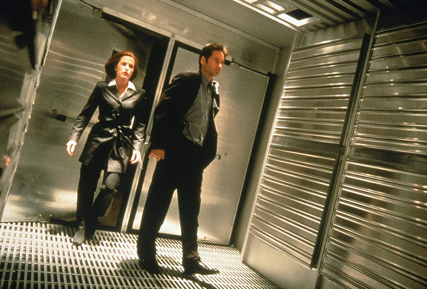 Agents Dana Scully (Gillian Anderson) and Fox Mulder (David Duchovny) enter the domes in The X Files (1998)