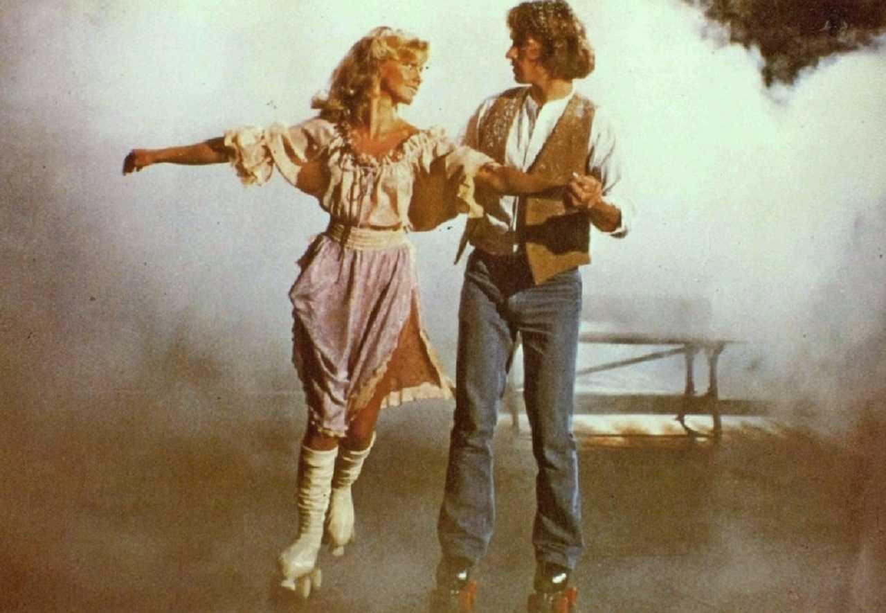 Olivia Newton-John and Michael Beck go rollerskating in Xanadu (1980)