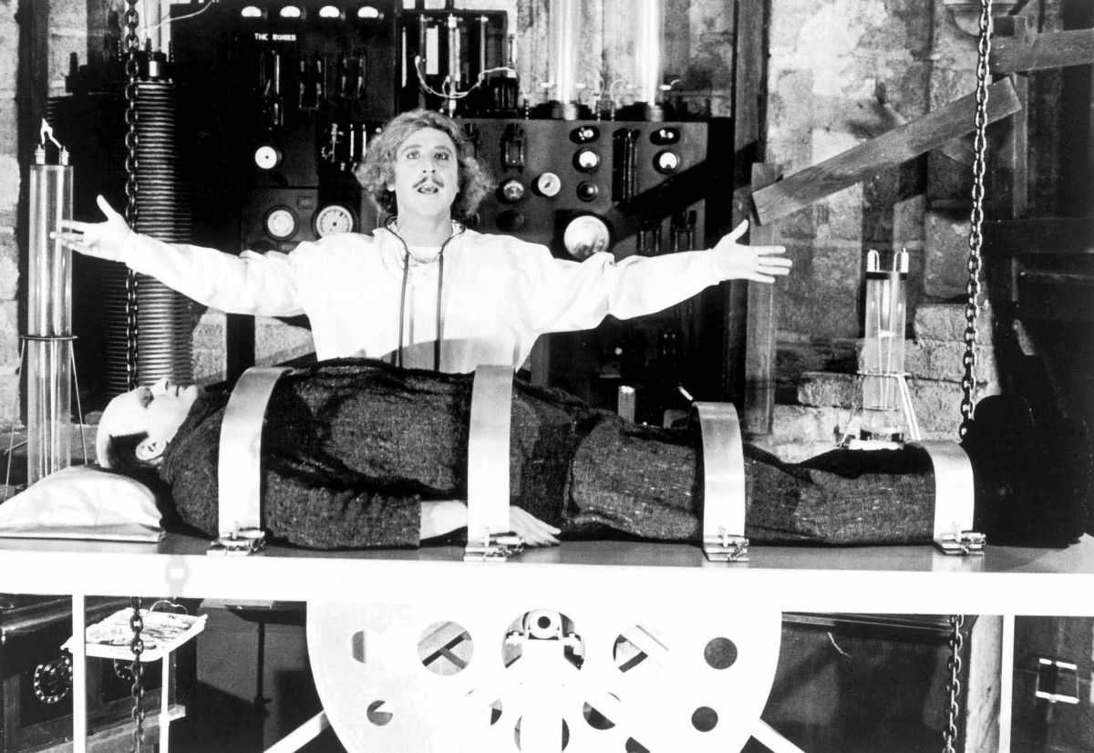 Frederick Frankenstein (Gene Wilder), the latest descendant of the family name, prepares to revive his monster (Peter Boyle) in Young Frankenstein (1974)