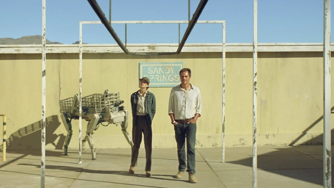 Kodi Smit-McPhee, Michael Shannon and robot in Young Ones (2014)