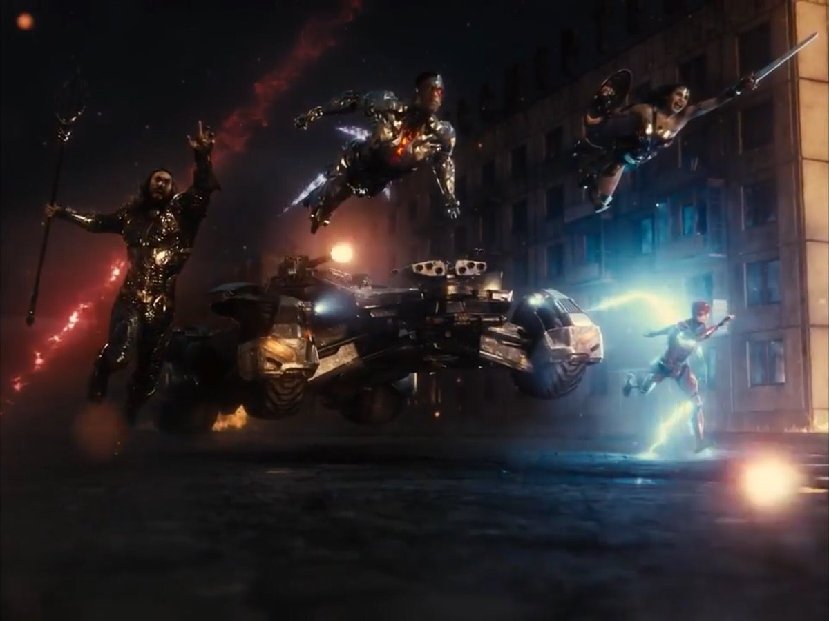 (l to r) Aquaman (Jason Momoa), Cyborg (Ray Fisher), Wonder Woman (Gal Gadot) and The Flash (Ezra Miller), along with the Batmobile head off into action in Russia in Zack Snyder's Justice League (2021)