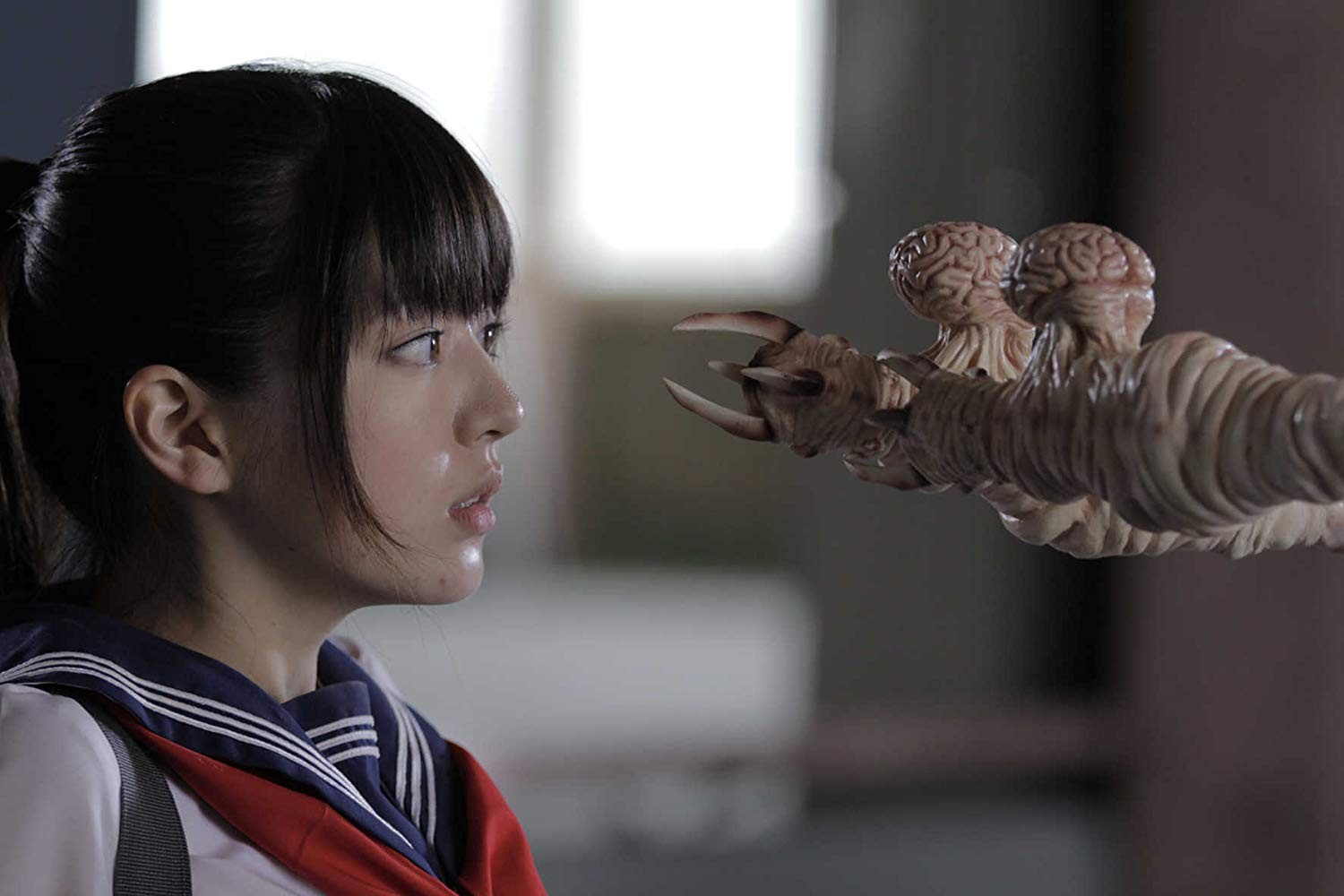 Schoolgirl heroine Megumi (Arisa Nakamura) faces an ass parasite in Zombie Ass: Toilet of the Dead (2011)