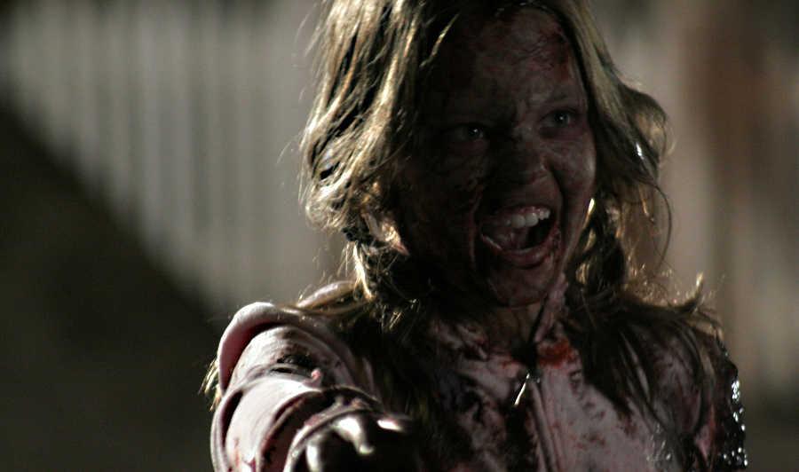 Zombie Sydney Sweeney attacks in Zombies of Mass Destruction (2009)