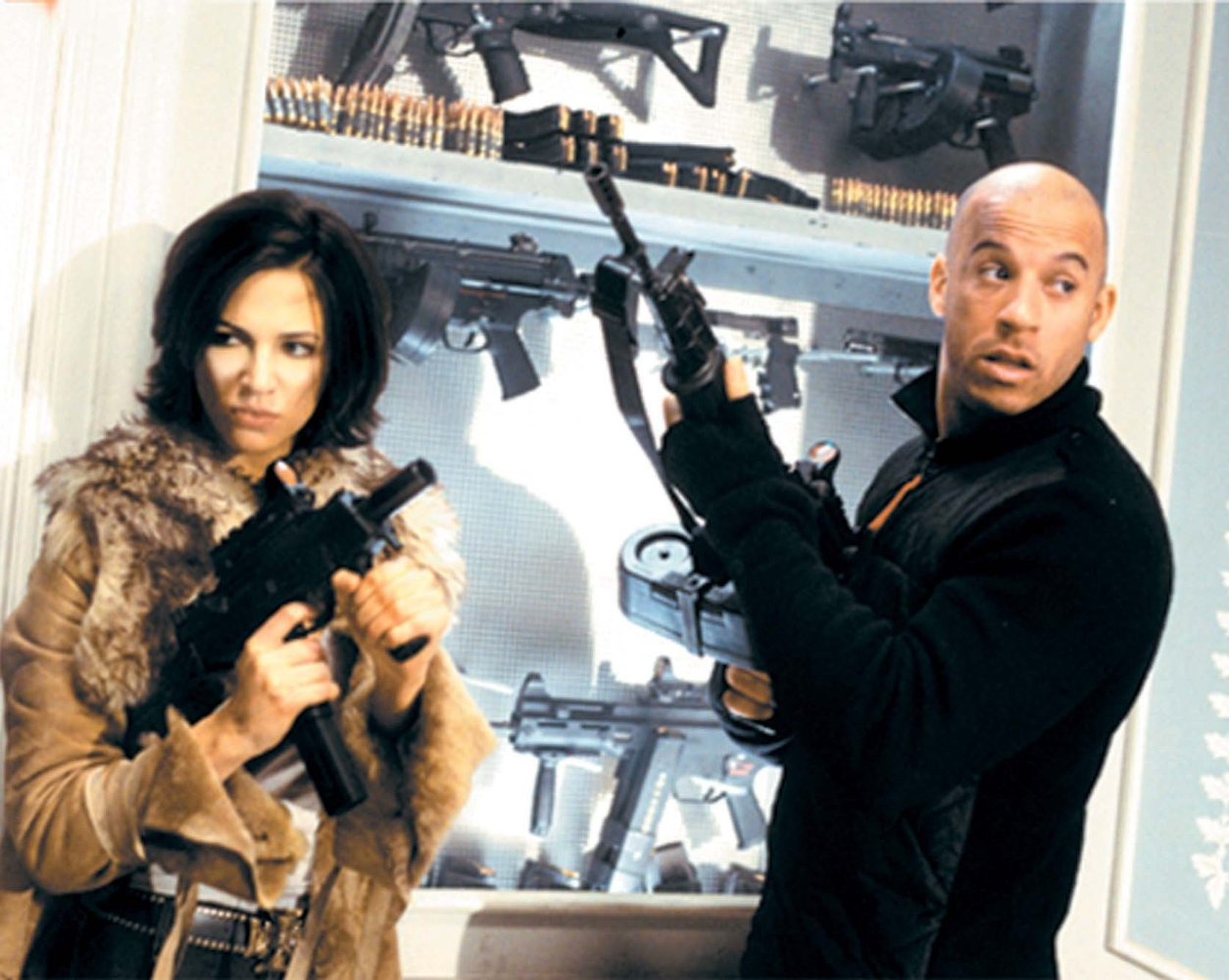 Asia Argento and Vin Diesel prepare for action in xXx (2002)